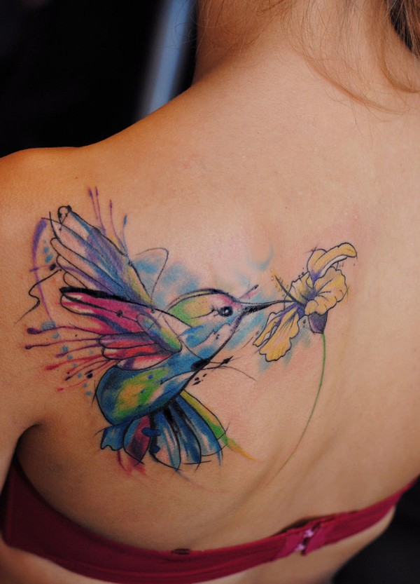 Watercolor hummingbird tattoo on back