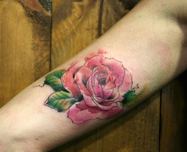 Watercolor like painted big rose tattoo on arm