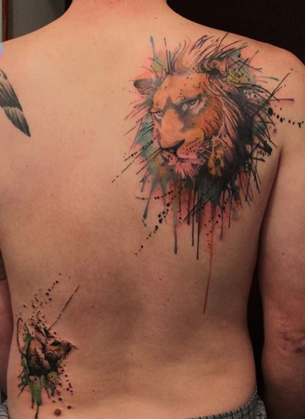 Watercolor lion tattoo on back