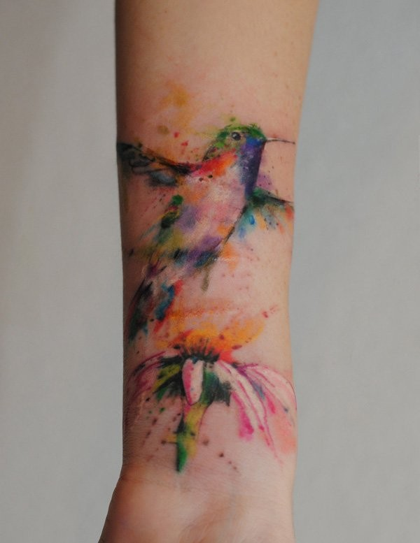 Watercolor lovely hummingbird forearm tattoo