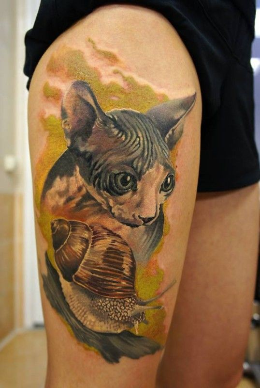 Watercolor sphynx cat and snail tattoo on leg