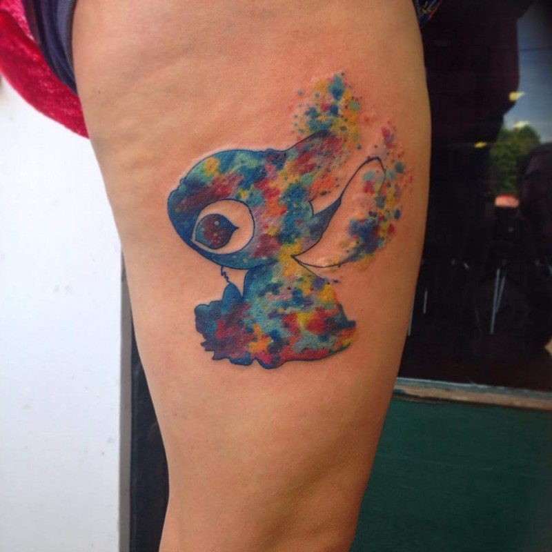 Watercolor style awesome looking cartoon hero tattoo on thigh