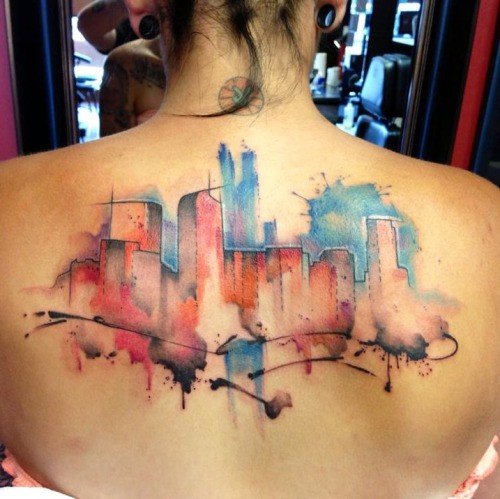 Watercolor style back tattoo of city buildings