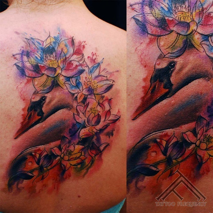 Watercolor style beautiful painted swan tattoo on back combined with flowers