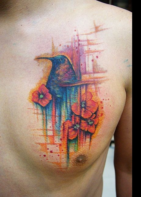 Watercolor style big chest tattoo of humming bird and flowers