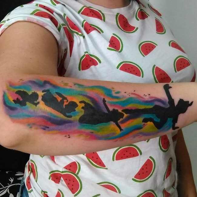 Watercolor style big forearm tattoo of Peter Pan and friends
