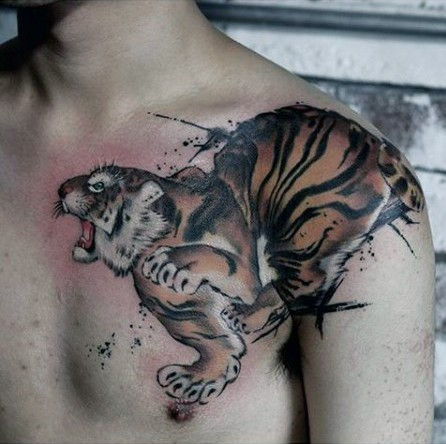 Watercolor style chest and shoulder tattoo of tiger