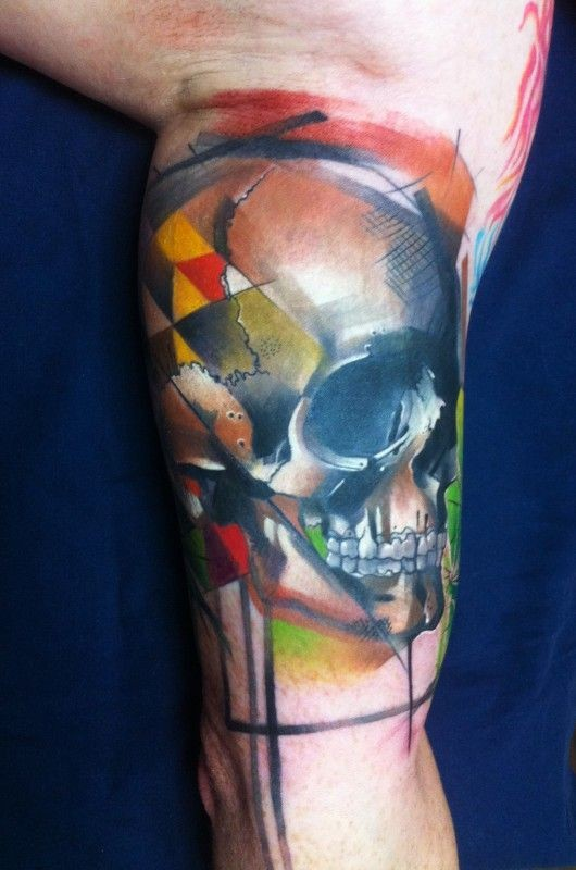 Watercolor style colored arm tattoo human skull