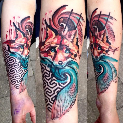 Watercolor style colored arm tattoo of cute fox with ornaments