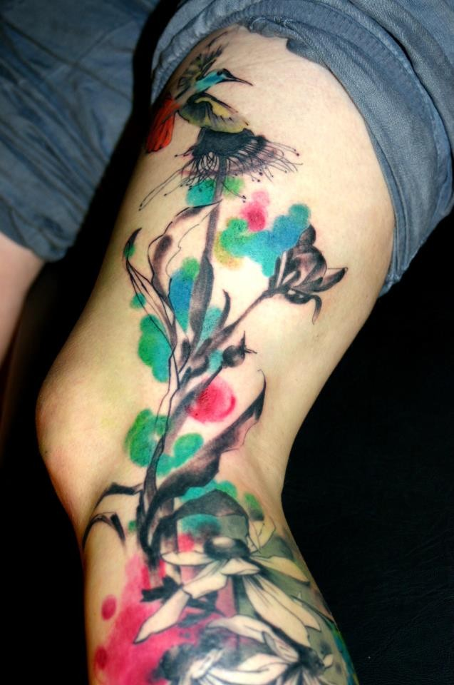 Watercolor style colored blooming tree with bird