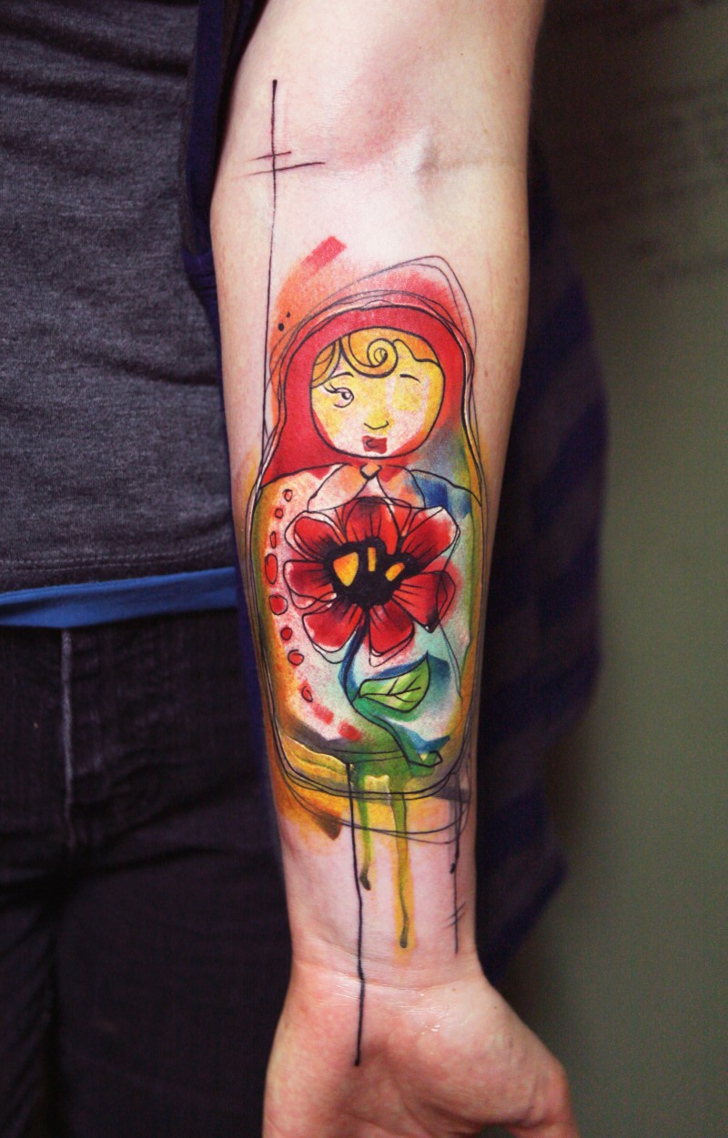 Watercolor style colored forearm tattoo of Matryoshka doll