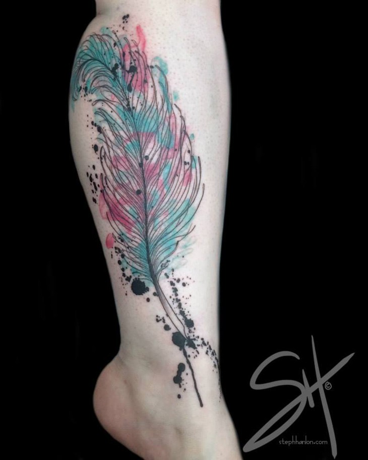 Watercolor style colored leg tattoo of feather and ink for Feather tattoo on thigh