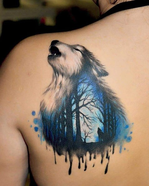 Watercolor style colored scapular tattoo of wolf stylized with night forest