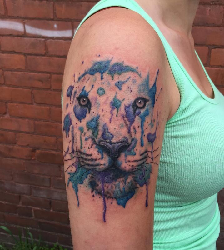 Watercolor style colored shoulder tattoo of tiger face