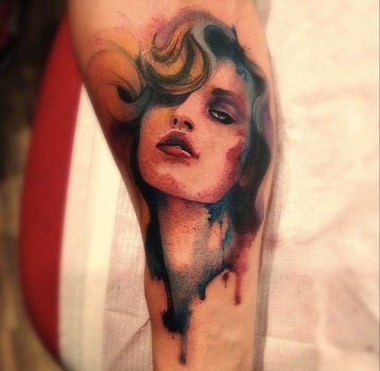 Watercolor style colored tattoo of seductive woman face