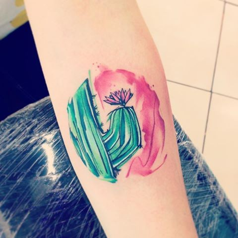 Watercolor style colorful forearm tattoo of cute cactus