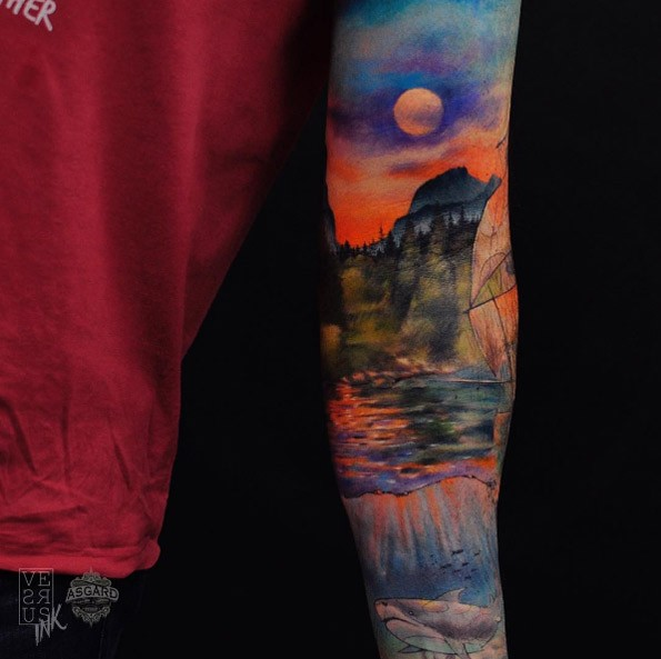 Watercolor style colorful sleeve tattoo of nice sailing ship and shark