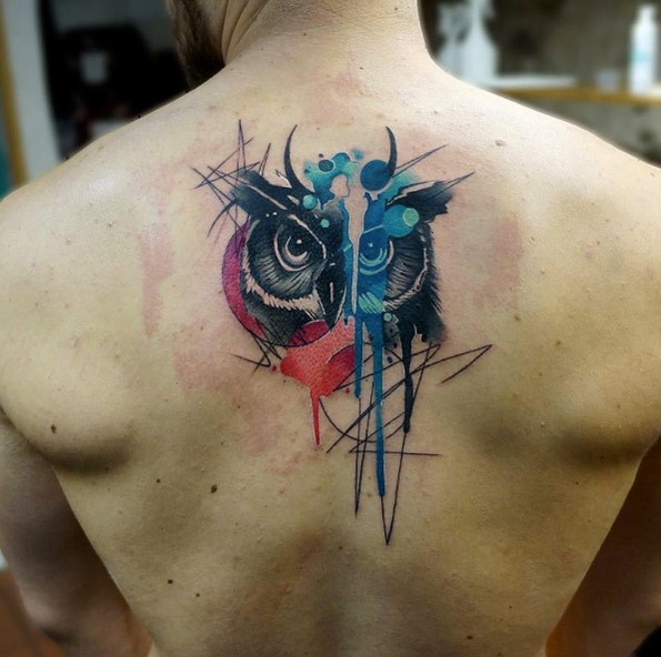 Watercolor style creative painted upper back tattoo of owl with moon shaped ornament