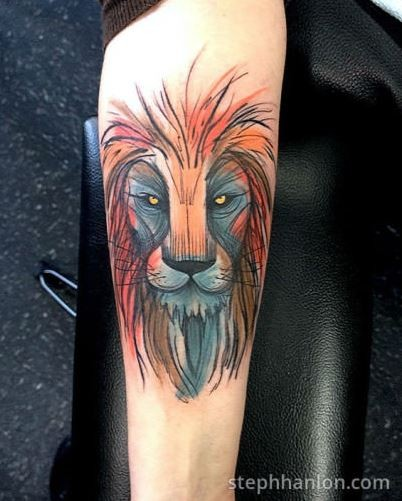 Watercolor style forearm tattoo of steady lion face