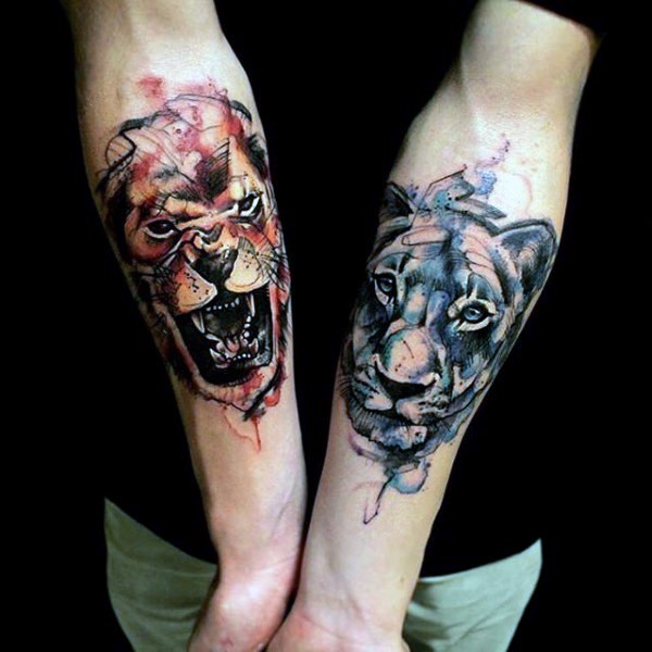 Watercolor style forearm tattoo of various lions