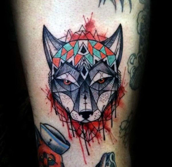 Watercolor style impressive looking thigh tattoo of fantasy wolf with ornaments