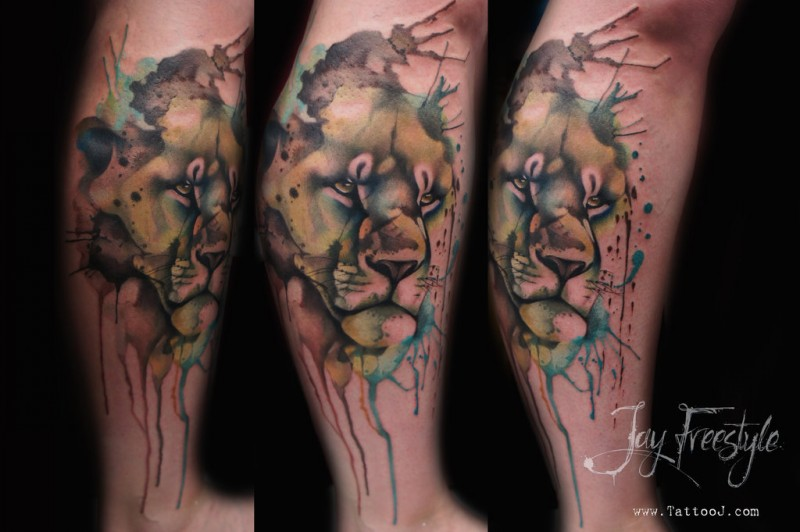 Watercolor style interesting looking leg tattoo of lion head