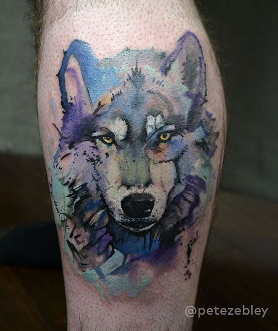 Watercolor style nice looking leg tattoo of wolf head
