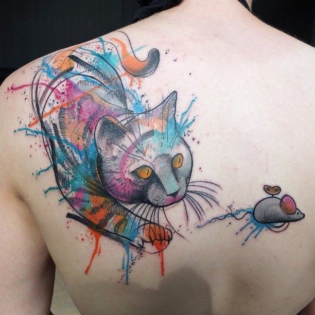 Watercolor style nice looking upper back tattoo of cat with toy mouse
