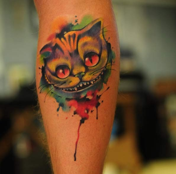 Watercolor style painted multicolored forearm tattoo of smiling cat