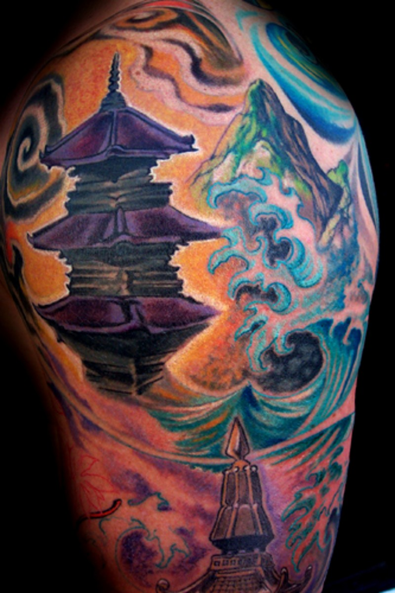 Watercolor style painted shoulder tattoo of old Asian temple and mountains