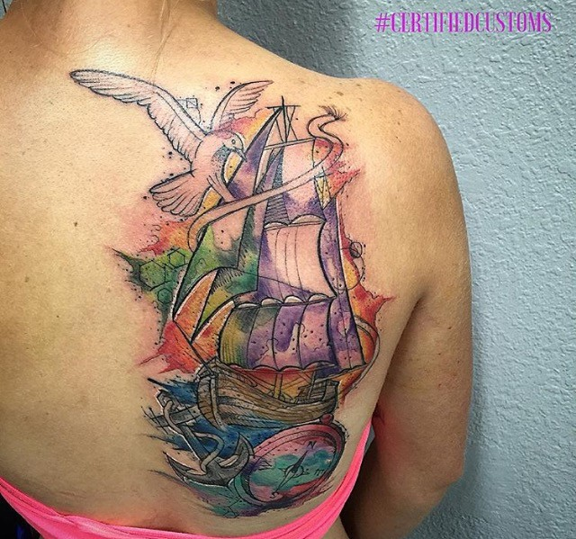 Watercolor style shoulder tattoo of sailing ship, compass and bird