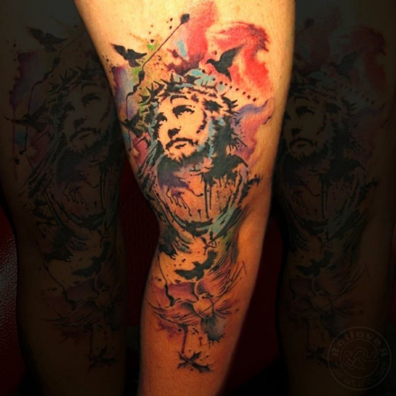 Watercolor style sleeve tattoo of Jesus with flowers