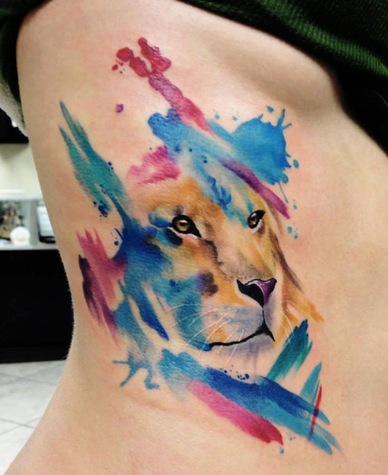 Watercolor lion tattoo on side