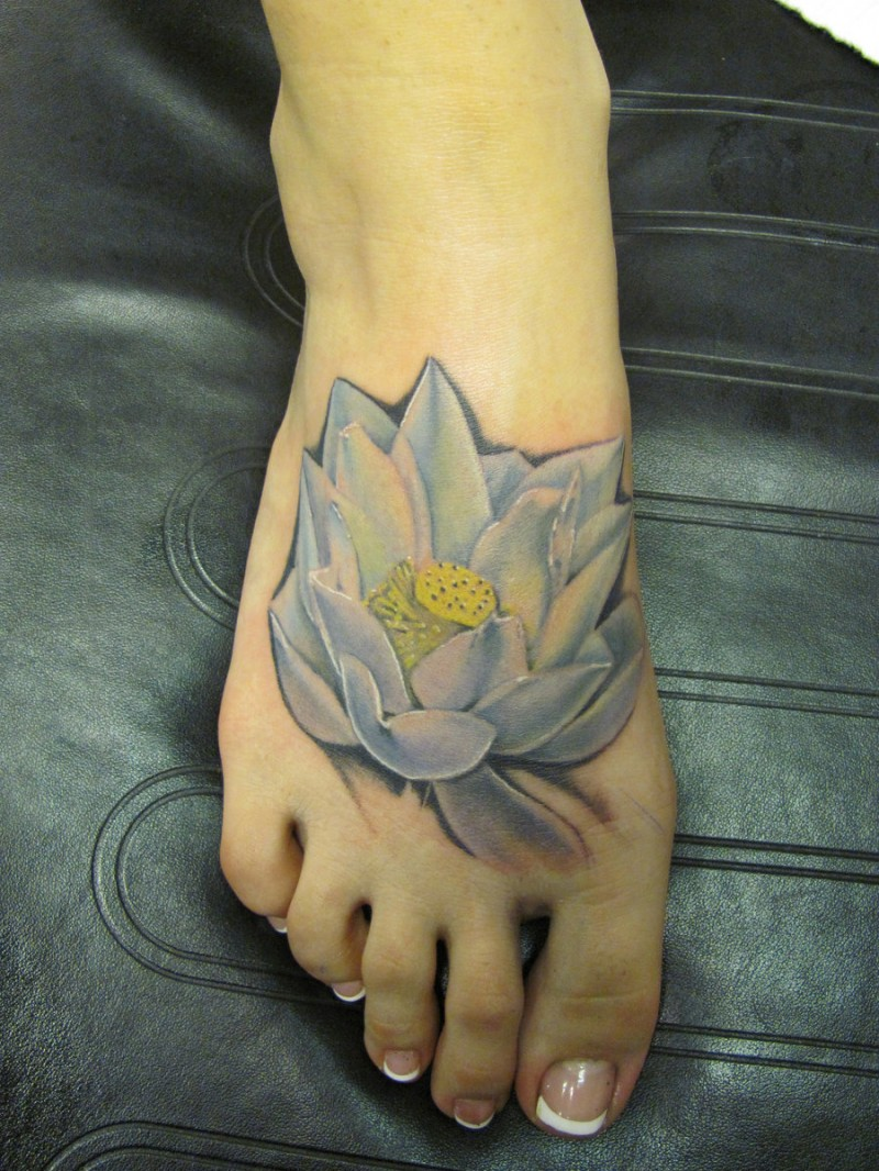 Watercolor white lotus tattoo on foot for White lotus tattoo