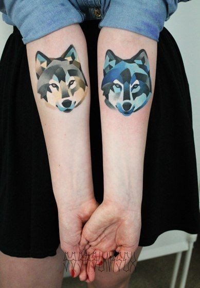Watercolor wolves forearm tattoo by Sasha