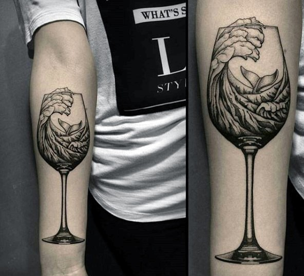 Whale swimming in water waves in vine glass black and white forearm length tattoo in surrealism style