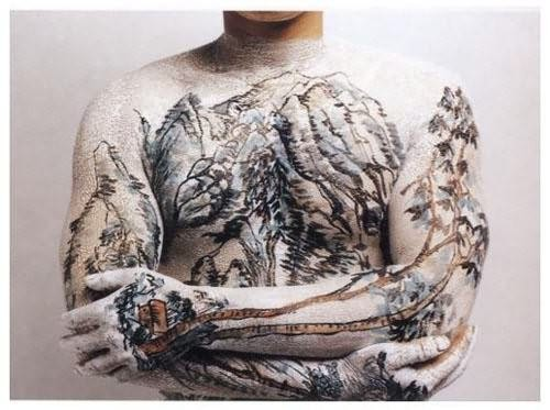 White chinese forest tattoo on body