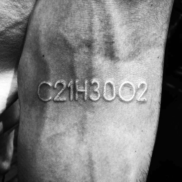 White ink code like letters and numbers tattoo
