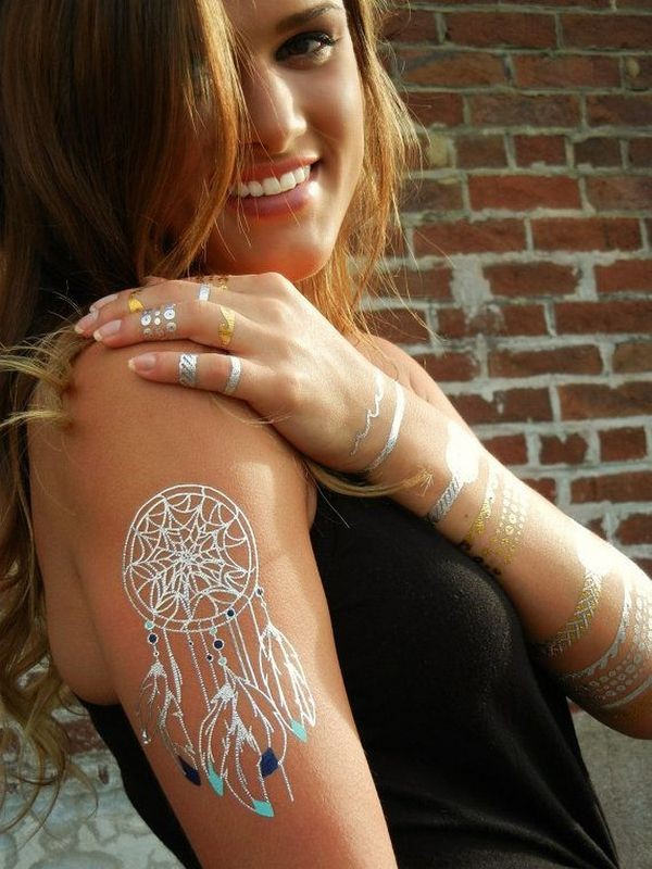 White ink style colored shoulder tattoo of dream catcher
