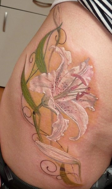 White lily flower tattoo on ribs