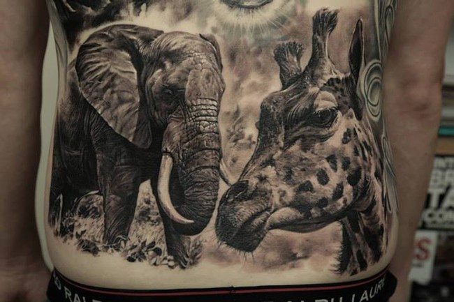 Wild like style very detailed black and white animals tattoo on whole back