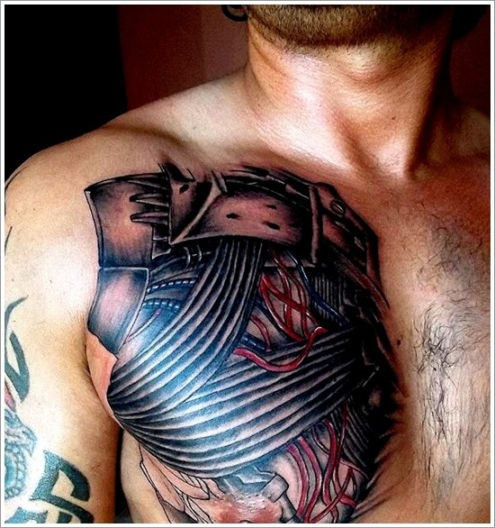 Wires and electrical tape tattoo on chest