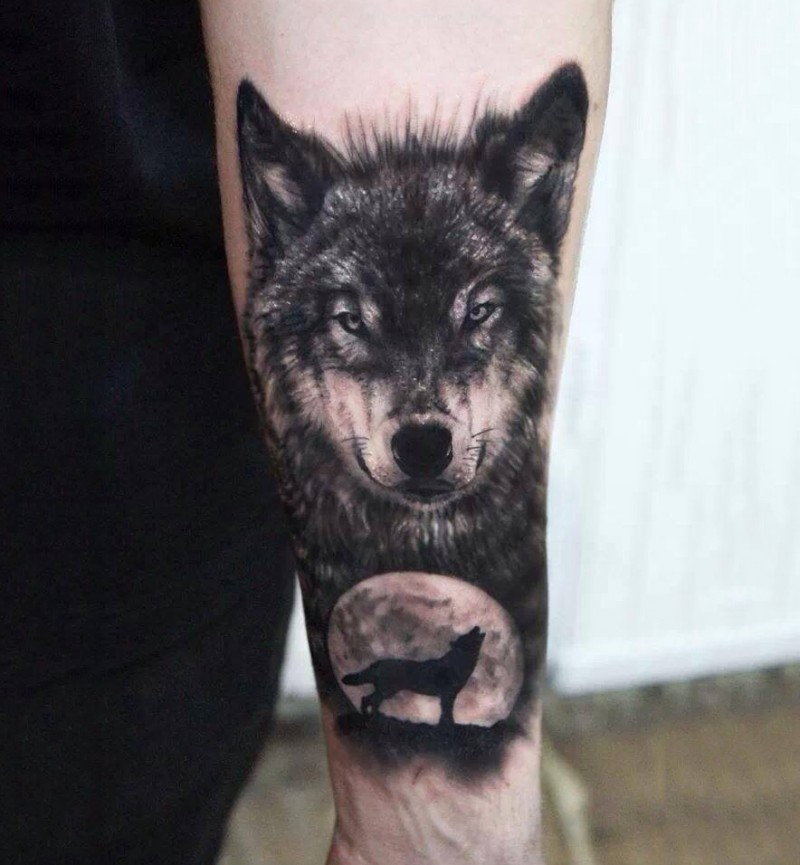 Wolf face tattoo with moon in dark
