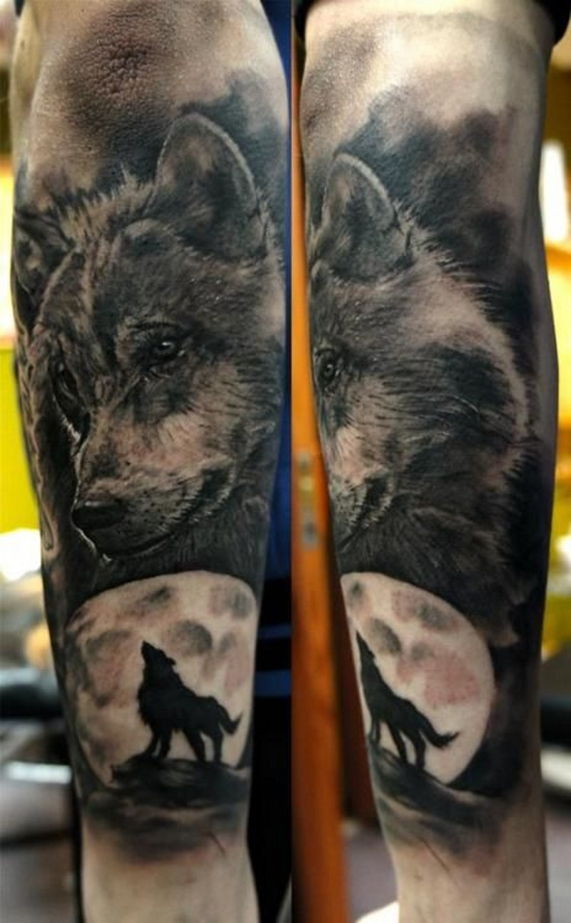 Wolf head with silhouette of a wolf forearm tattoo