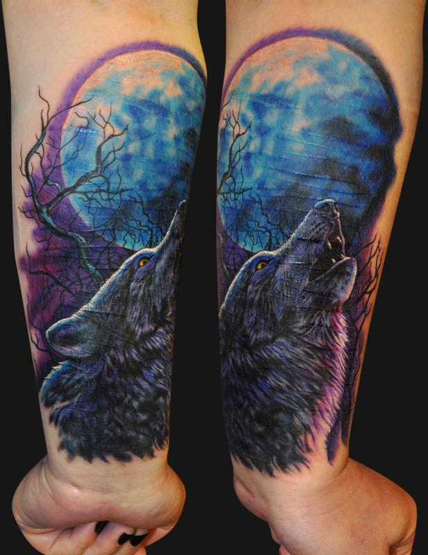 Colored wolf and moon tattoo on wrist