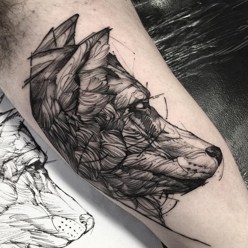 Wolf&quots head detailed black ink tattoo on biceps in engraving style