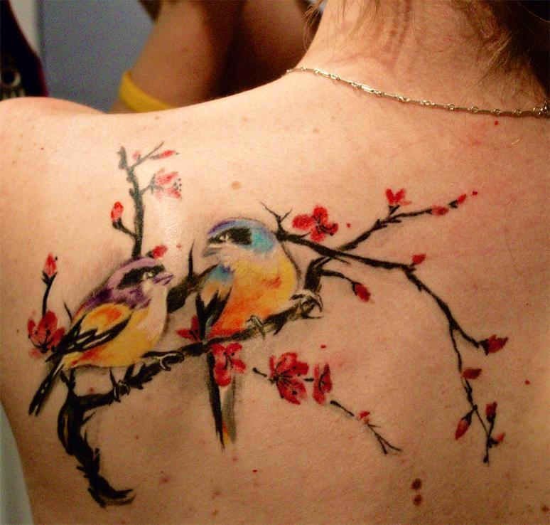 Womens birds tattoo