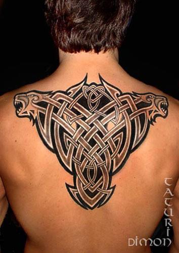 Wonderful black celtic knot tattoo on back
