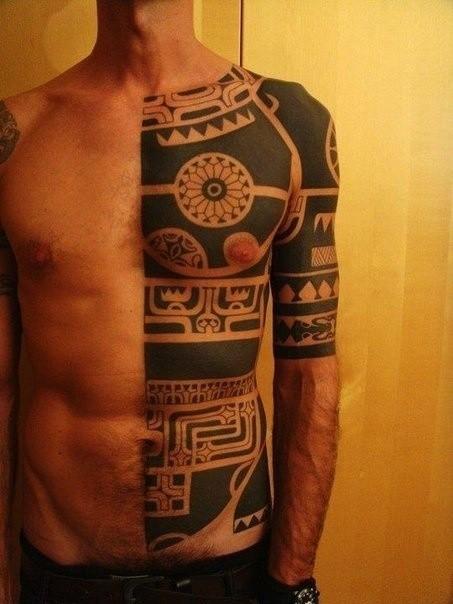 Wonderful black ink maori tattoo on half body