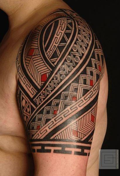 Wonderful black red maori tattoo on shoulder